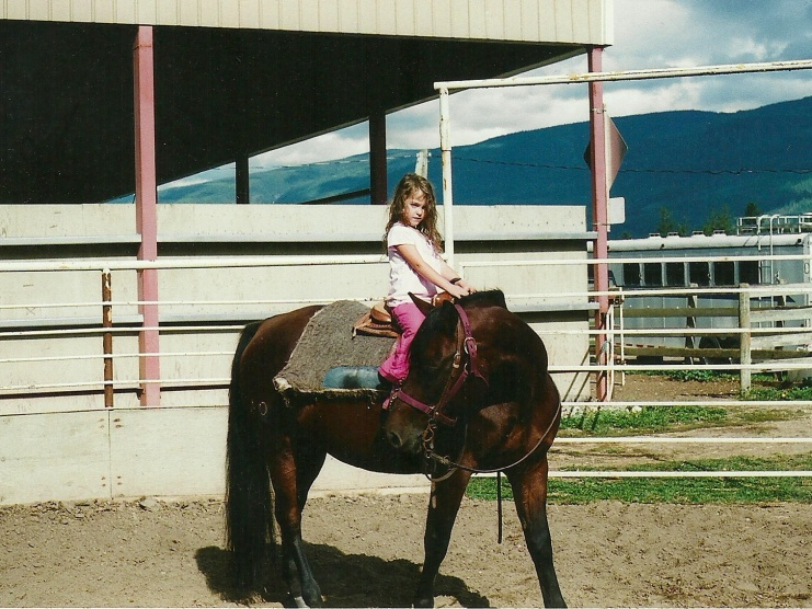 Abby McCluskey riding Noble-T Bay Bea
